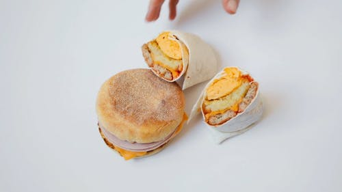 Close Up Shot of an English Muffin Breakfast Burger and Burrito