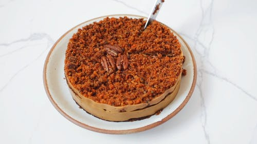 Close Up Shot of a Carrot Cake Being Sliced