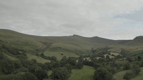 Aerial View of Mountain Range and Grassland