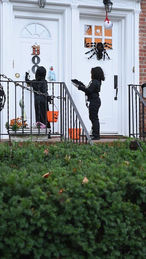 Children Knocking on Door for Trick or Treat