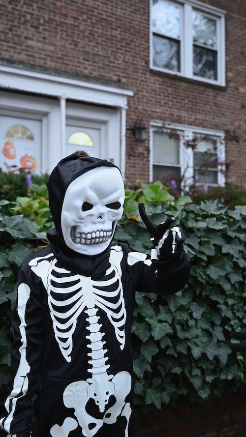 Children in Skeleton Costume During Halloween