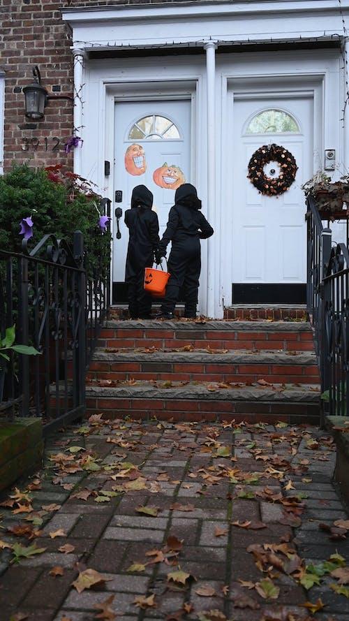 Children Knocking on Door Trick or Treating