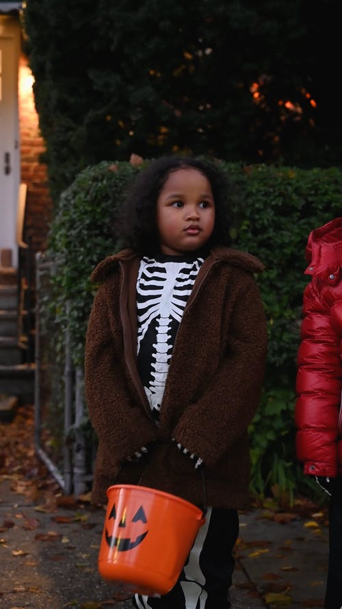Kids Waiting on the Street for Trick or Treat