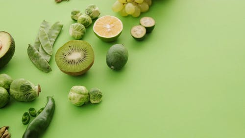 Flat Lay of Green Fruits and Vegetables
