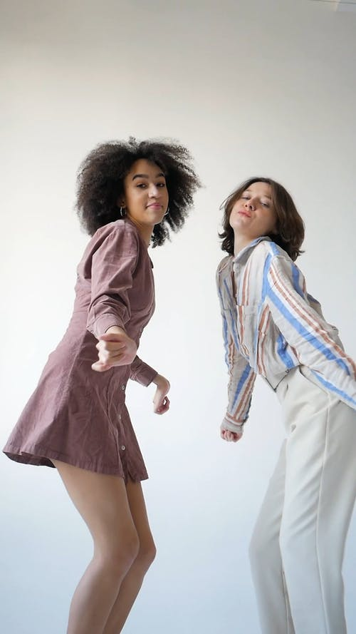 Young Women Dancing and Looking at Camera