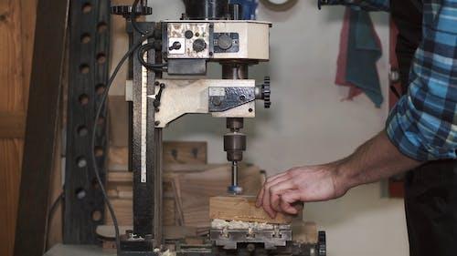 Carpenter Working with a Machine