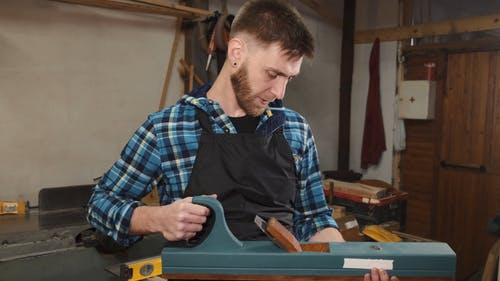 Carpenter with Woodworking Equipment