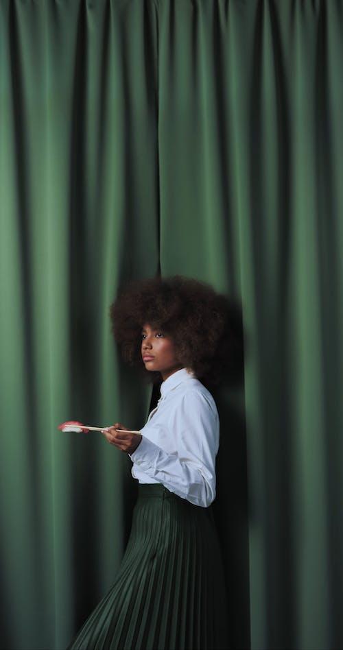 African American Female Eating Sushi