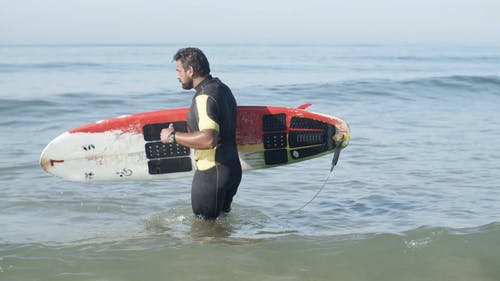 Man Riding a Surfboard
