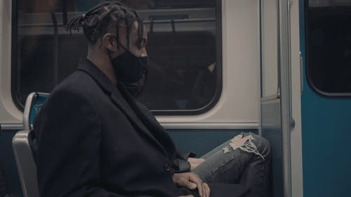 Man and Woman Wearing Face Mask Talking in the Metro