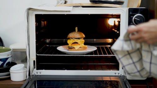 Chef Making a Cheeseburger