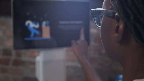 Close-Up Video Of Person Using A Touchscreen Monitor