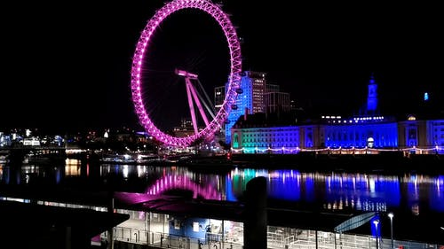 Time-Lapse Video of Lighted Ferris Wheel During Nighttime