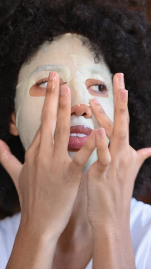 Woman Using a Face Mask