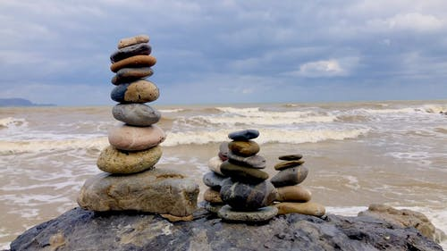 Rocks Balancing On The Seashore