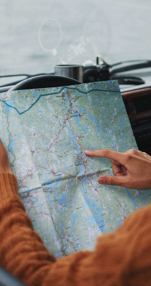 Bearded Man Pointing at Road Map