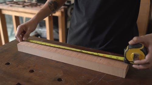 A Carpenter Marking on a Wooden Plank