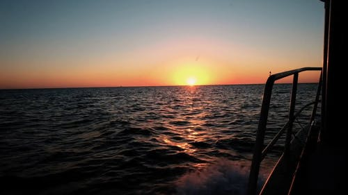 Boat on the Ocean During Sunset