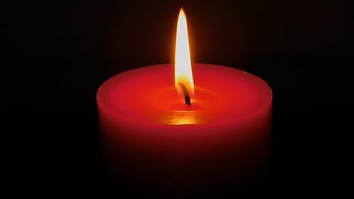 Close Up View of a Lighted Red Candle