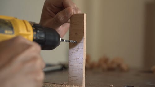 Drilling Holes On A Piece Of Wood
