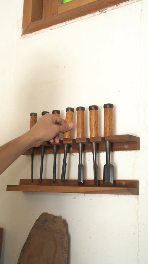 Person Choosing a Perfect Chisel for his Work