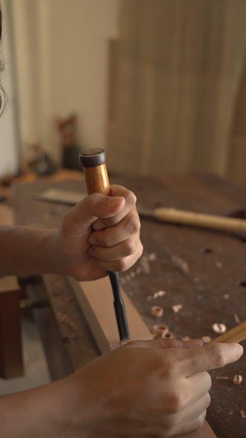 Joiner working on hardwood plank
