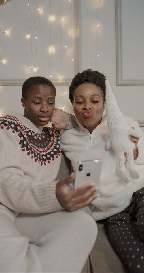 Two Women Having a Video Call Through the Smartphone