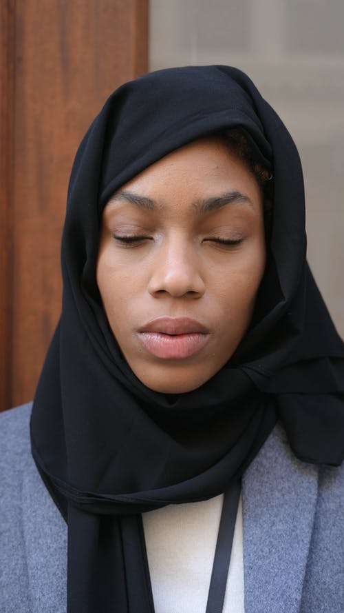 A Woman Wearing Black Hijab Looking Serious