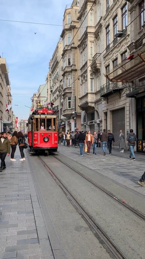 Front View of a Tram Moving Forward in the Street
