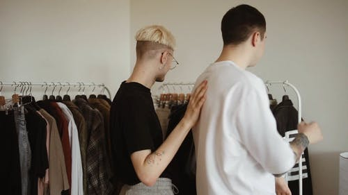 Back View of Couple Picking Clothes from the Clothing Rack