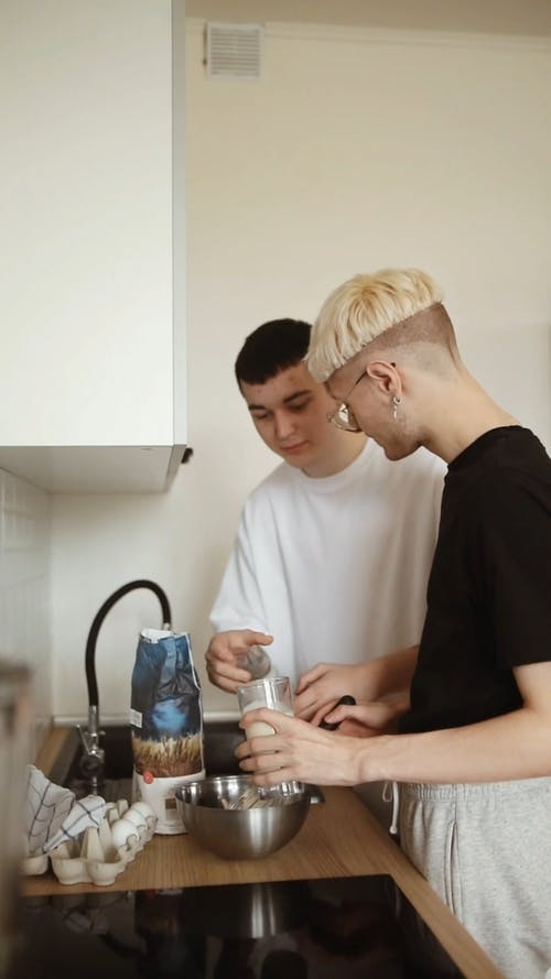 Two Guys Preparing Food in the Kitchen
