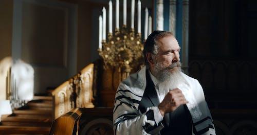 A Man Inside a Church Looking at a Distance