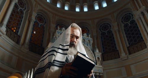 Low Angle View of a Man Reading a Torah