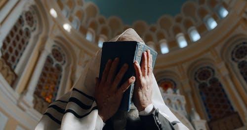 Low Angle View of An Elderly Man Praying