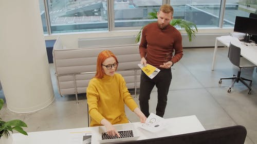 A Man And A Woman Collaborating Their Work