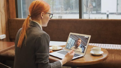 A Woman In A Video Call While Having Snack