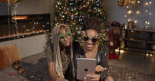Two Women Having Fun Looking at an Ipad