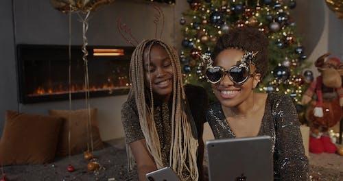 Two Women Having Fun While Using an Ipad
