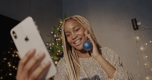 A Woman Having a Video Call Through the Smartphone