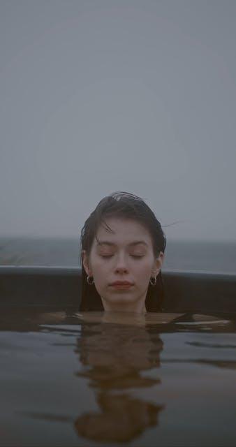 A Woman Soaking In Hot Water