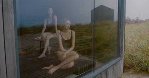 Two Women Bathing In A Sauna