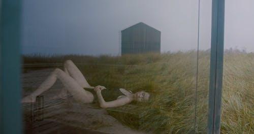A Woman lying Down Inside A sauna