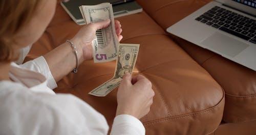 A Woman Segregating Her Money