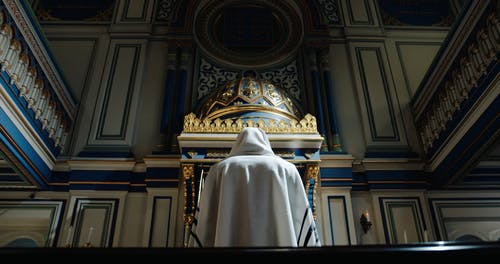 Low Angle View of a Person Worshipping Near a Torah Ark