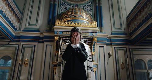 A Man Praying and Worshipping