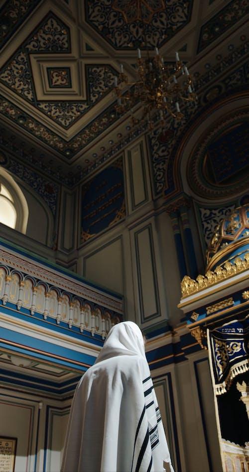 A Jewish Person In Deep Prayers Inside A Church