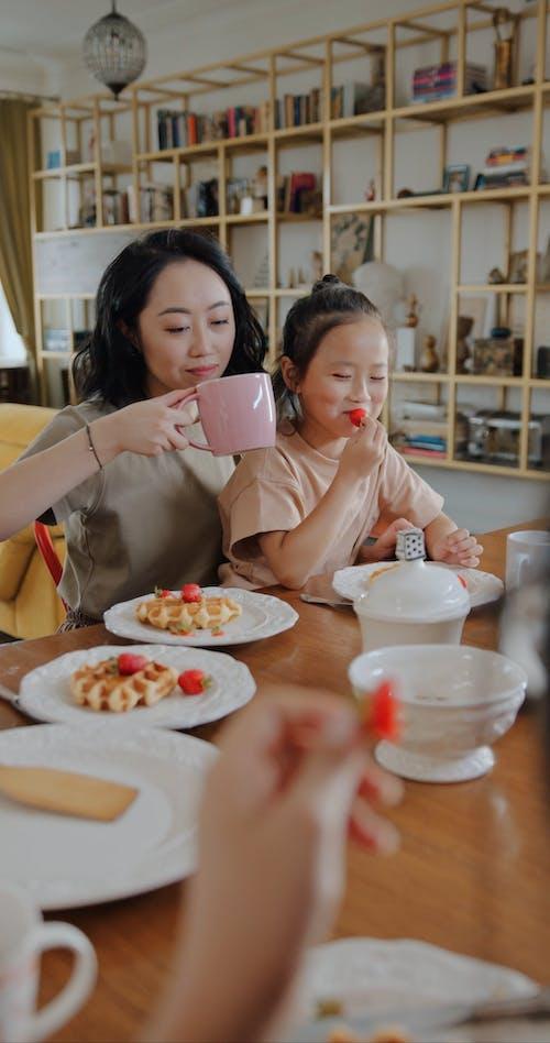 An Asian Family Having Breakfast