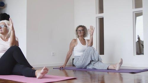 Elderly Women Practicing Yoga