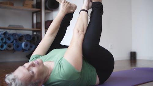 An Elderly Woman Doing Yoga