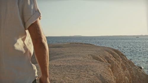 Man Walking on the Cliff Edge